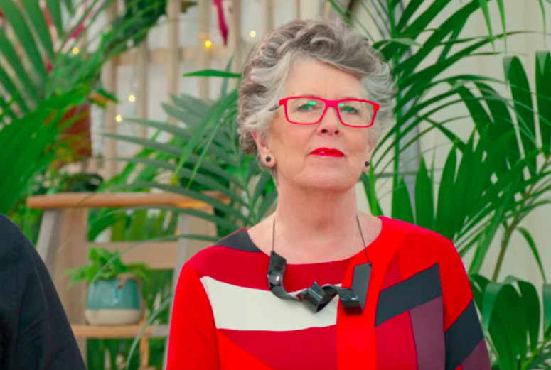 Prue Leith wearing red glasses and a black chunky necklace.