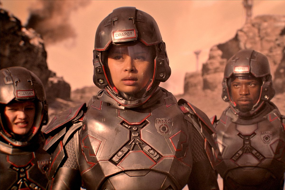 Actor Frankie Adams as Martian Marine Bobby Draper leads her squad on a training exercise in full power armor.