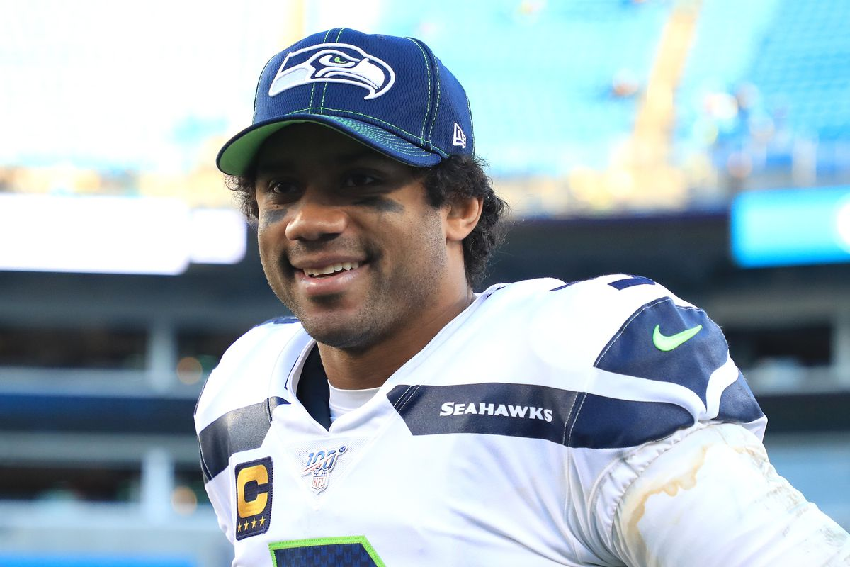 Russell Wilson of the Seattle Seahawks watches on after defeating the Carolina Panthers 30-24 at Bank of America Stadium on December 15, 2019 in Charlotte, North Carolina.