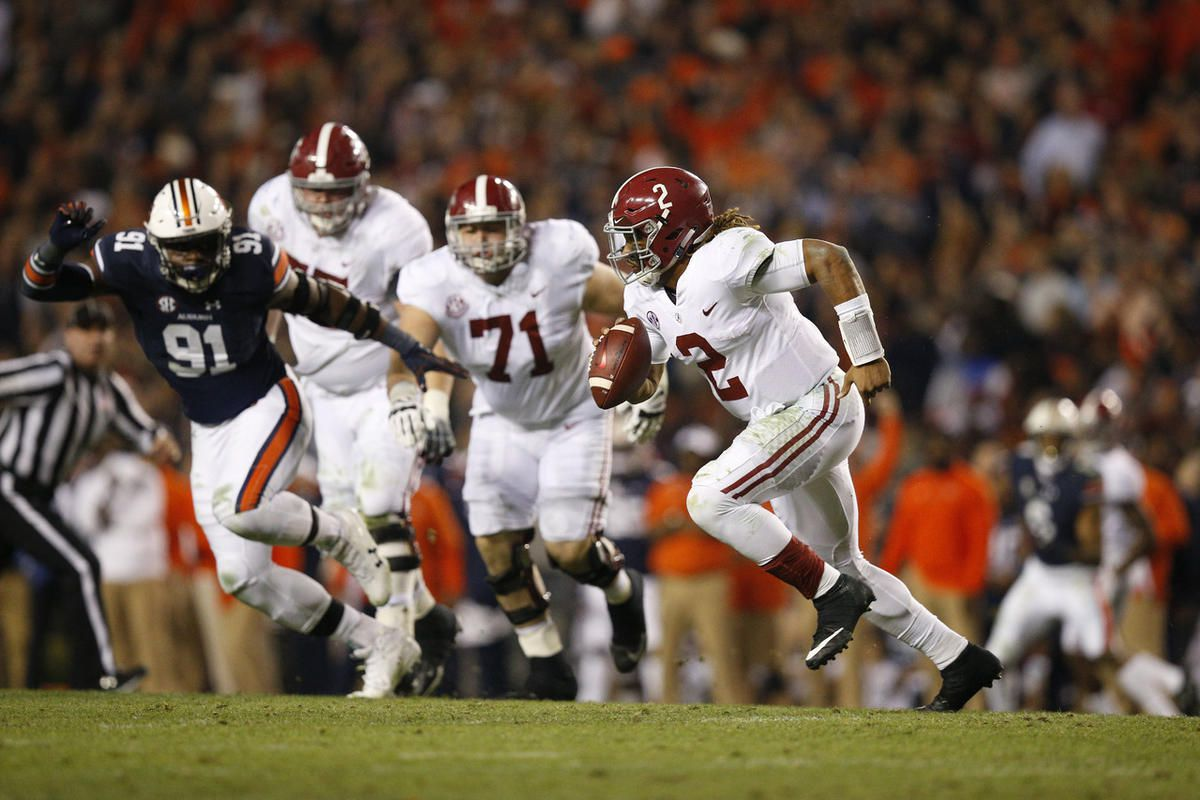 Alabama quarterback Jalen Hurts runs the ball during the second half of the Iron Bowl NCAA college football game Auburn, Saturday, Nov. 25, 2017, in Auburn, Ala. (AP Photo/Brynn Anderson)