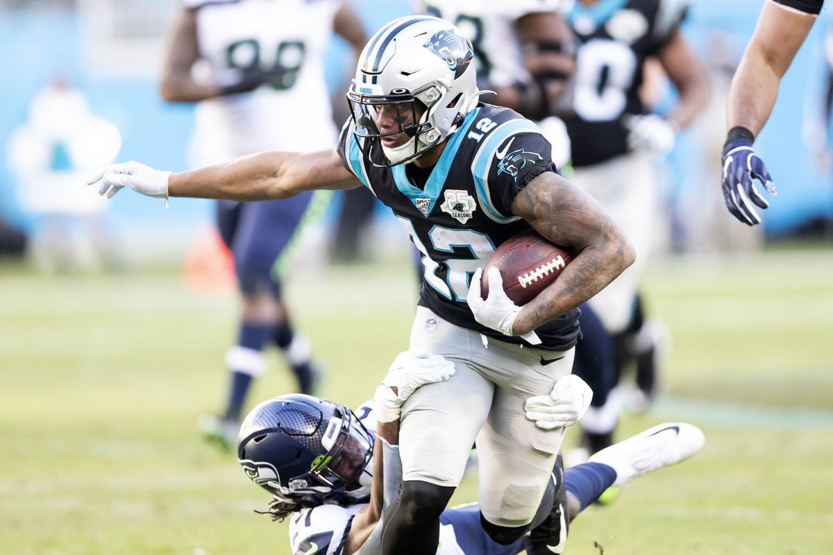 D.J. Moore of the Carolina Panthers is tackled by Tre Flowers of the Seattle Seahawks during a game between Seattle Seahawks and Carolina Panthers at Bank of America Stadium on December 15, 2019 in Charlotte, North Carolina.