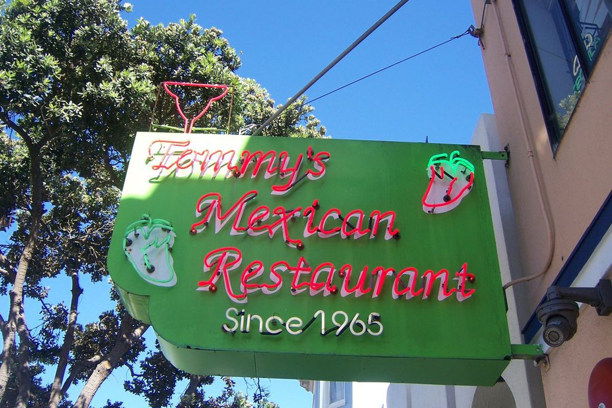 Exterior neon sign of Tommy's Mexican Restaurant in the Richmond neighborhood
