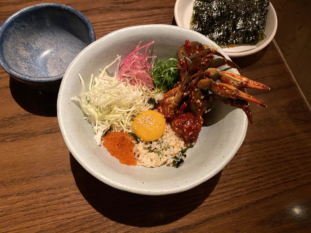 Kawi's new crab dish: brick-red spicy raw crab sits in a bowl over perilla rice and salmon roe