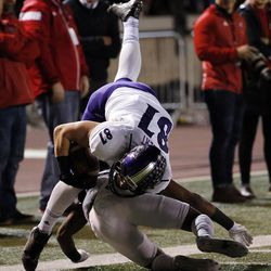 Weber State Wildcats tight end Andrew Vollert is tackled by Southern Utah Thunderbirds cornerback Jalen Russell after a long run during NCAA football in Cedar City on Saturday, Dec. 2, 2017.