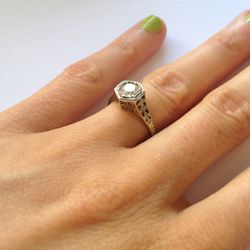 """""""This is my engagement ring, [which dates] from the 1930s. My now-husband bought it from Doyle & Doyle. This was before I was dealing in antique engagement rings—but I still haven't found an antique ring I love as much as this one. I picked out the"""