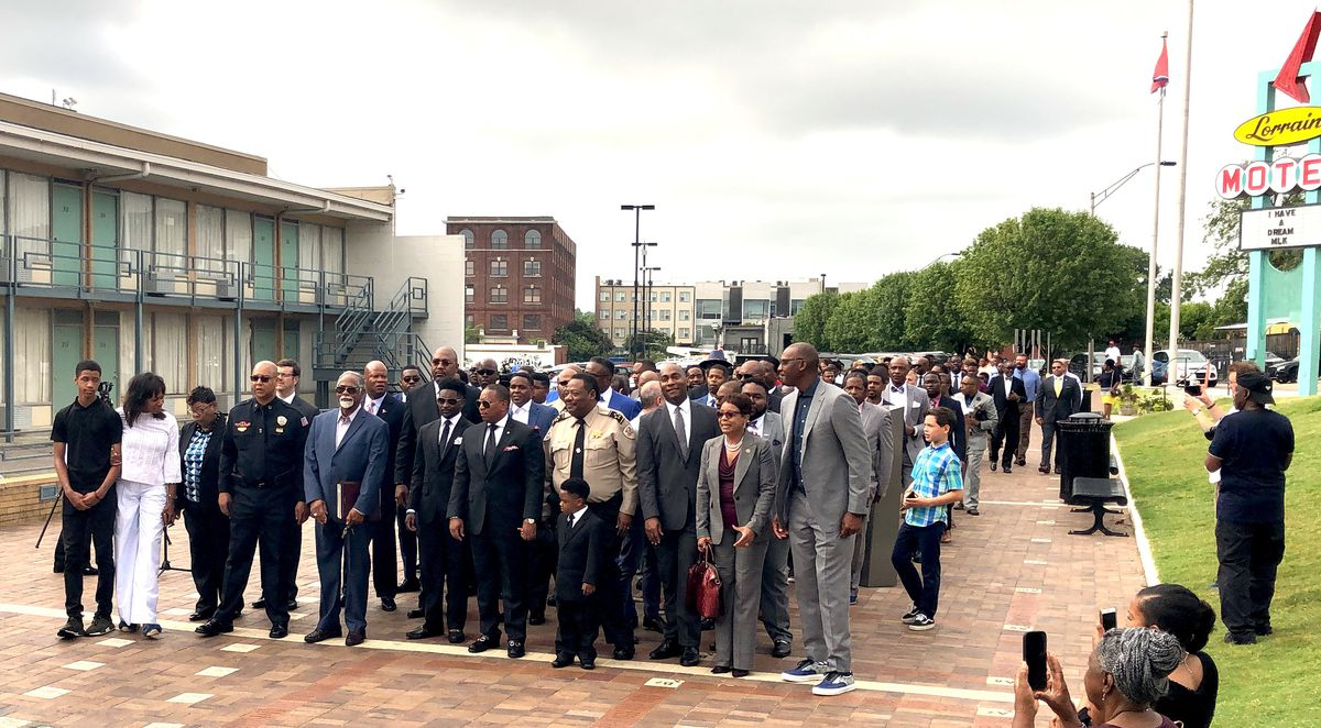 Memphis leaders and students march into the National Civil Rights Museum ahead of Superintendent Joris Ray's announcement of an initiative focused on black boys.