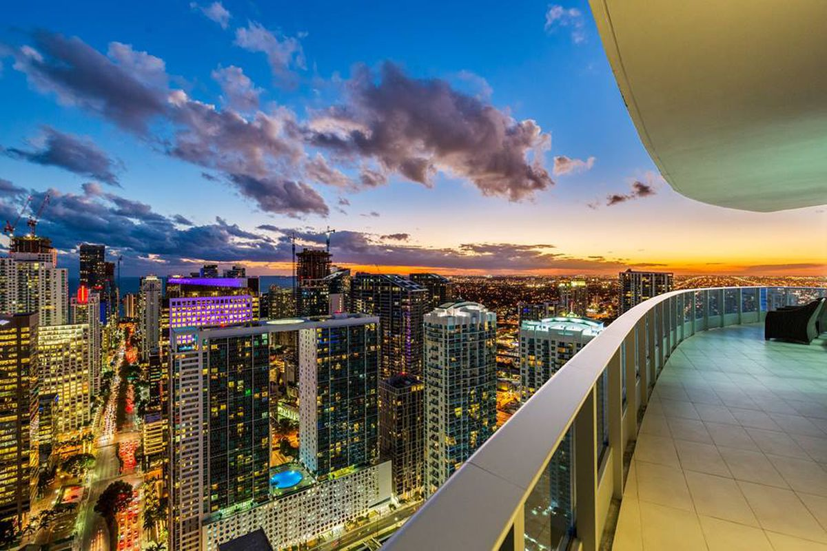 A sunset view off a penthouse terrace in downtown miami