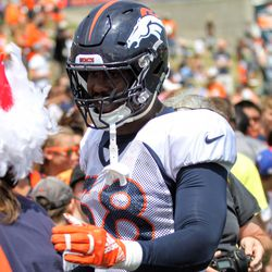 Broncos OLB Von Miller chats with the already infamous road-crossing-Von Miller-meeting-chicken.