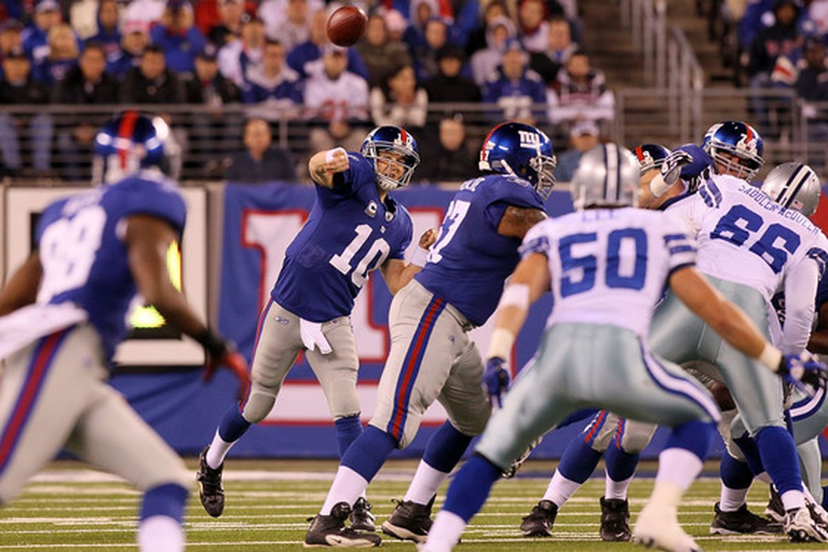 EAST RUTHERFORD NJ - NOVEMBER 14:  Eli Manning #10 of the New York Giants throws a pass against the Dallas Cowboys on November 14 2010 at the New Meadowlands Stadium in East Rutherford New Jersey.  (Photo by Jim McIsaac/Getty Images)