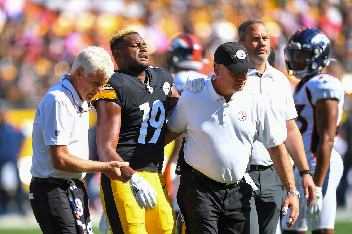 JuJu Smith-Schuster #19 of the Pittsburgh Steelers reacts after being injured against the Denver Broncos during the second quarter at Heinz Field on October 10, 2021 in Pittsburgh, Pennsylvania.