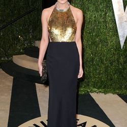 From the front, Chrissy Teigen looks perfectly presentable in black and gold.