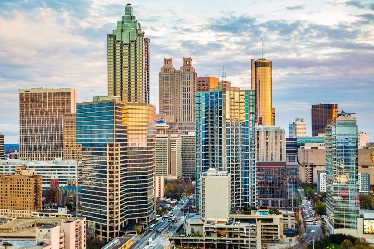 Glimmering windows of Atlanta skyscrapers reflect the sun and sky.