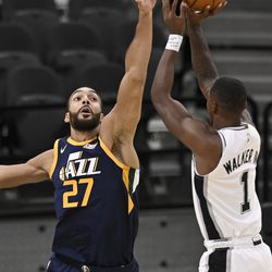 Utah Jazz's Rudy Gobert (27) attempts to block a shot by San Antonio Spurs' Lonnie Walker IV during the first half of an NBA basketball game, Sunday, Jan. 3, 2021, in San Antonio.