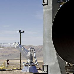 ATK engineers walk around the location of the Ares I first stage ground test at the ATK facilities in Promontory, Utah, Thursday.