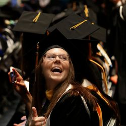 Rachel Burrup gives a thumbs-up to family before commencement exercises at Brigham Young University in Provo on Thursday, Aug. 13, 2015.  Burrup received a masters of science degree.