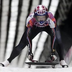 Noelle Pikus-Pace of the United States celebrates her silver medal win in the finish area after the women's skeleton competition at the 2014 Winter Olympics, Friday, Feb. 14, 2014, in Krasnaya Polyana, Russia.