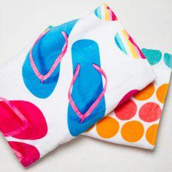 """<a href=""""http://www.target.com/Basic-Dot-2pc-Beach-Towel/dp/B003YYVBEI/ref=sc_qi_detaillink"""" rel=""""nofollow"""">Basic Dot Beach Towel & Photo Real Flip Flop Beach Towel</a>, $14 each<br />"""