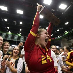 Mountain View High School's Kaylee Sinema (24) cheers with her team as she hoists the state championship trophy following the 5A volleyball state finals match at the UCCU Center on the Utah Valley University campus in Orem on Saturday, Nov. 9, 2019.
