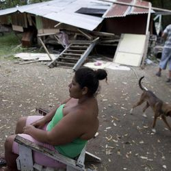 A woman sits in front a her earthquake damaged home in Nosara, Costa Rica, Thursday, Sept. 6, 2012.  A powerful, magnitude-7.6 earthquake shook Costa Rica and a wide swath of Central America on Wednesday.