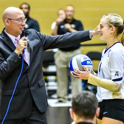 Jordan Pingel received the record-setting ball from her 2000th career dig from head coach Todd Dagenais.