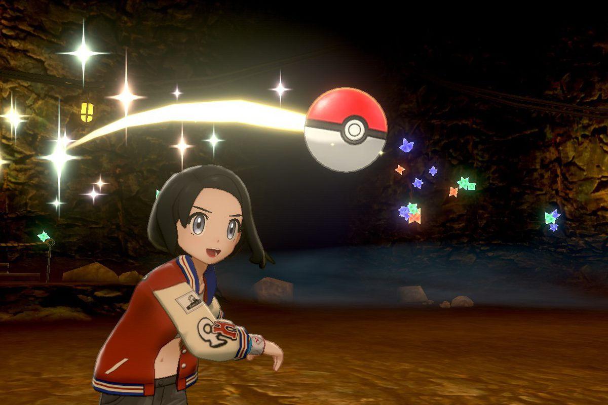 A Pokémon trainer throws a Poké Ball to catch a Pokémon
