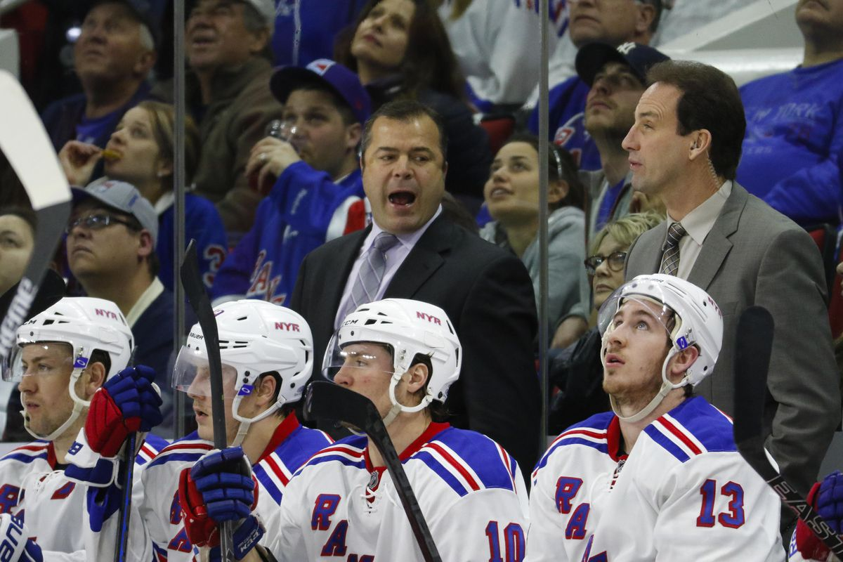 Alain Vigneault, New York Rangers coach, appears to want a cookie or something in this photo.