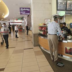 People get lunch at the food court at City Creek Center in Salt Lake City on Wednesday, May 6, 2020. The shopping center reopened Wednesday.