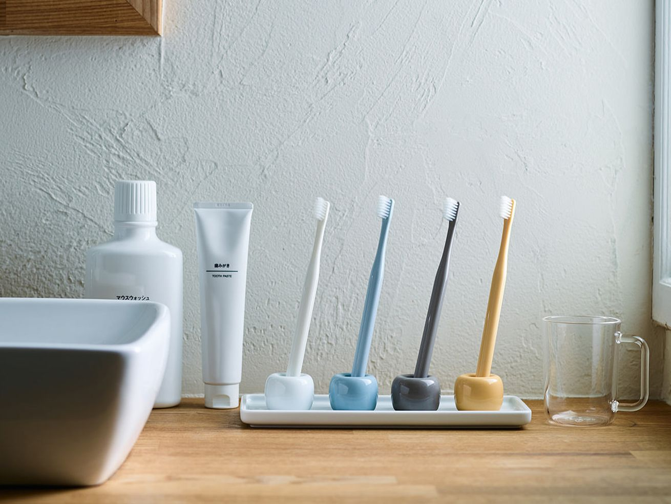 "The Muji Porcelain Toothbrush Stand (<a class=""ql-link"" href=""https://www.amazon.com/Muji-White-Porcelain-Tooth-Brush/dp/B00ICIGGI2"" target=""_blank"">$7.02</a>) is a simple, helpful tool that makes a hotel bathroom feel a bit more like home."
