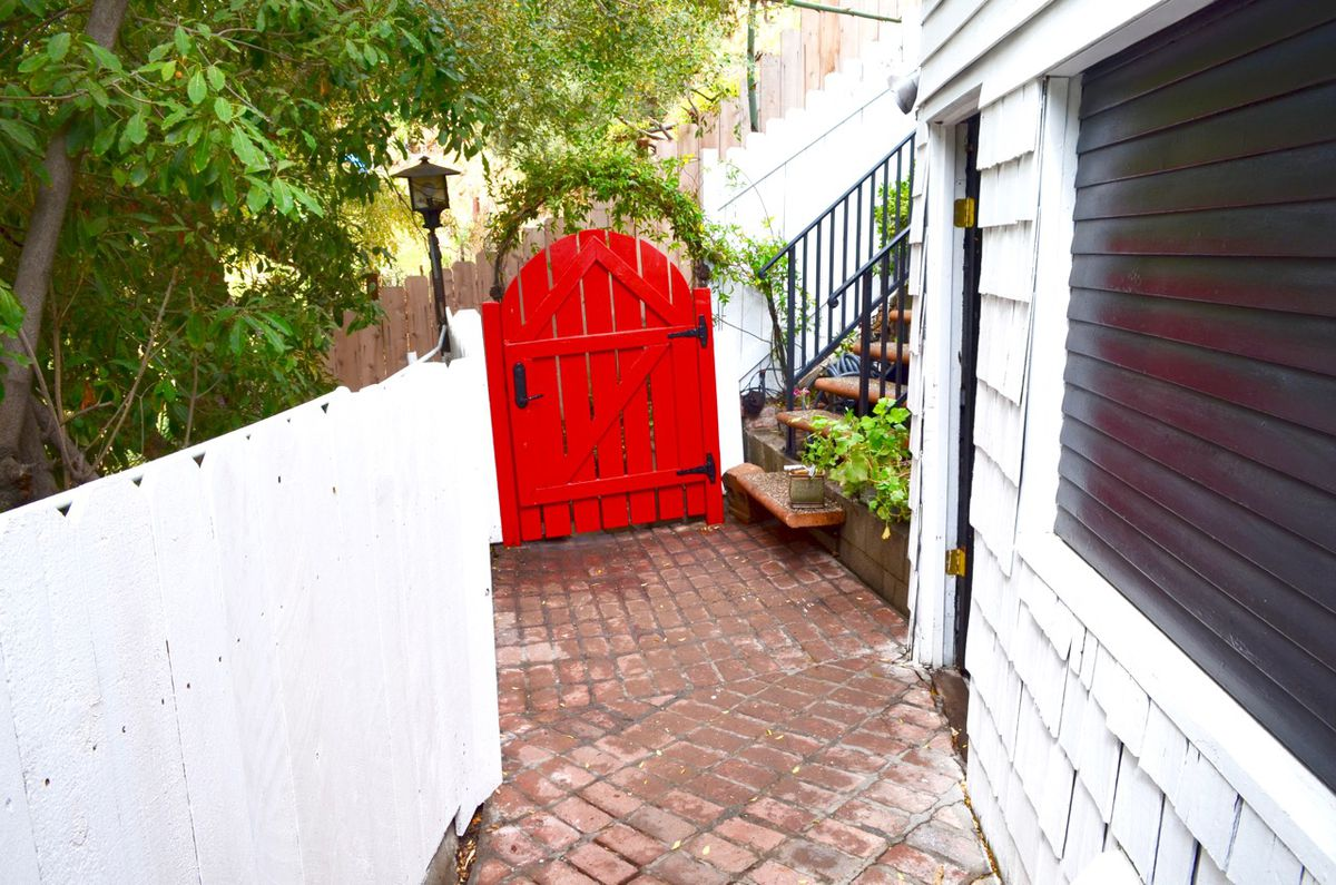 Red gate and tile walkway