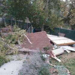 Inclement weather caused destruction in a Layton backyard Thursday, September 22, 2016. A tornado touched down in Weber County on Thursday, wrecking at least two homes in Washington Terrace, injuring one person and sending a group of teenagers running for their lives.