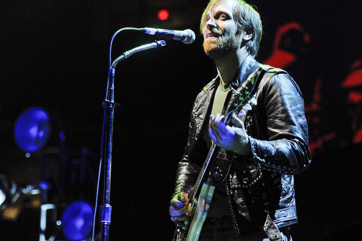 FILE - In this March 12, 2012 file photo, guitarist/vocalist Dan Auerbach of The Black Keys performs at Madison Square Garden in New York.  The Black Keys, The Red Hot Chili Peppers and English indie darlings Florence and the Machine will headline this ye