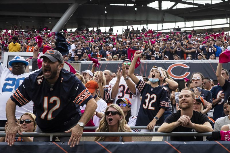 Fans cheer as the Chicago Bears take on the Detroit Lions at Soldier Field, Sunday, Oct. 3, 2021.