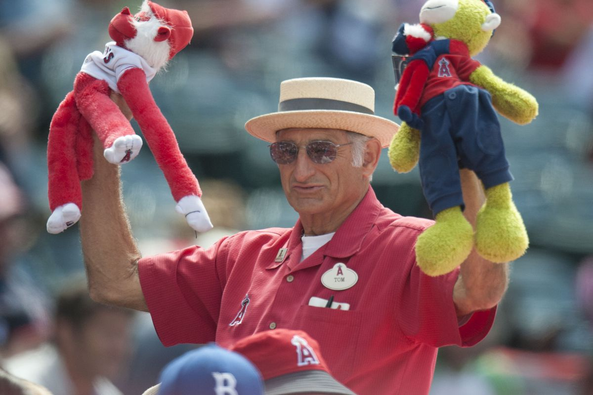 An usher dances with rally monkeys to no avail during the Angels' 8-3 loss to the Cleveland Indians Sunday at Angel Stadium.