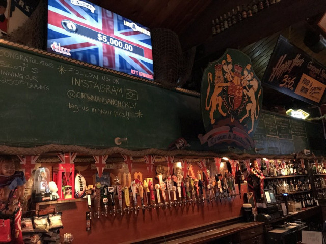 Bar interior featuring beer taps and British decorations