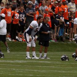Newly acquired center Steve Vallos talks with Offensive Consultant Alex Gibbs during stretches