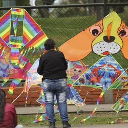Kites are displayed and sold in Bogota, Colombia, on Sunday, Aug. 25, 2019.