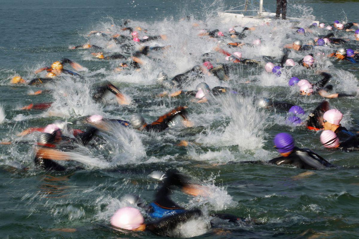WALCHSEE, AUSTRIA - SEPTEMBER 04: Athletes swim during the Challenge Walchsee-Kaiserwinkl Triathlon on September 4, 2011 in Walchsee, Austria.  (Photo by Alex Grimm/Getty Images for Challenge Walchsee-Kaiserwinkl)
