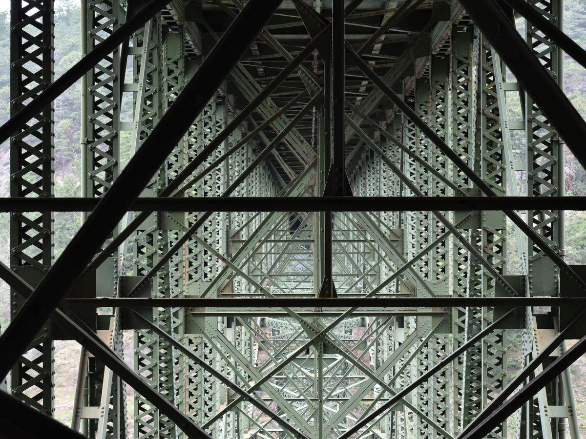 Scaffolding underneath a bridge makes a cascading diamond shape.