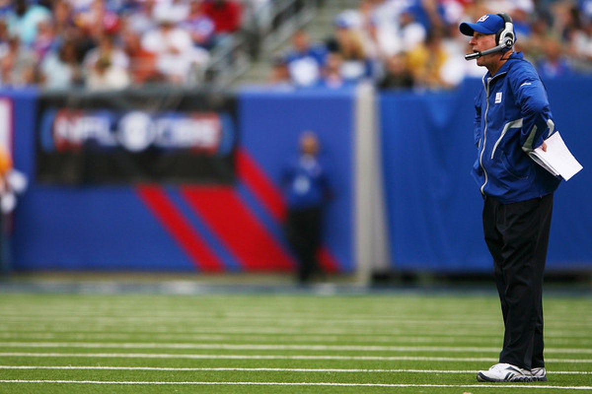 Head coach <strong>Tom Coughlin</strong> of the New York Giants yells after a penalty during a game against the Tennessee Titans Sunday. Coughlin has every right to be disturbed by what he saw from the Giants.  (Photo by Andrew Burton/Getty Images)