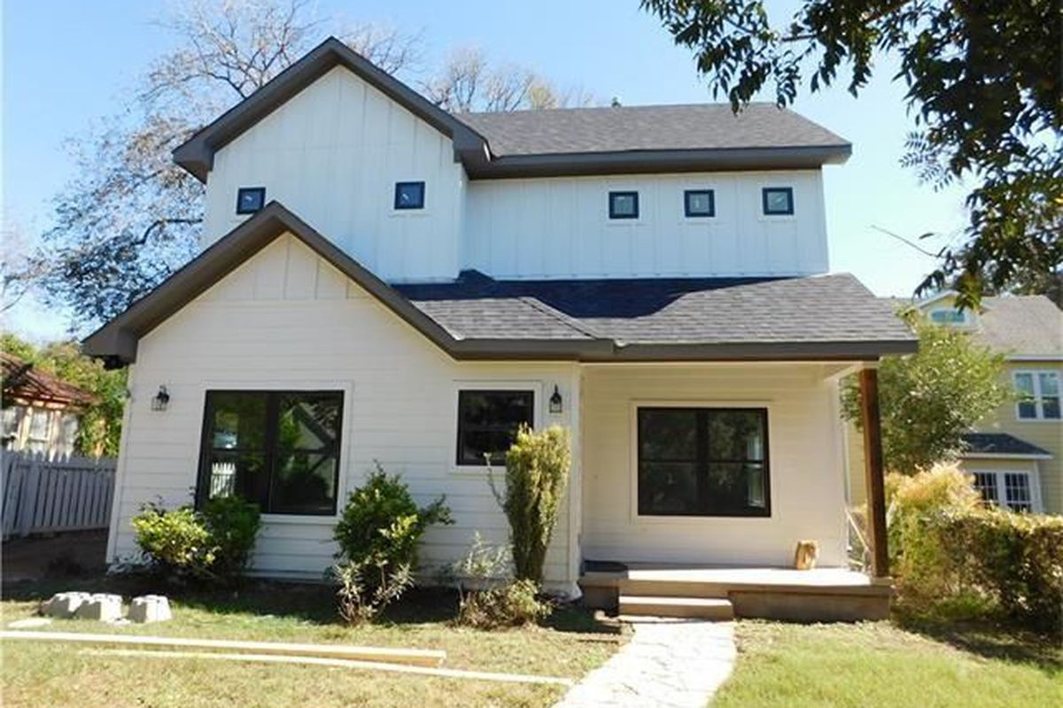Large new two-story white hardiplank house with brown roof
