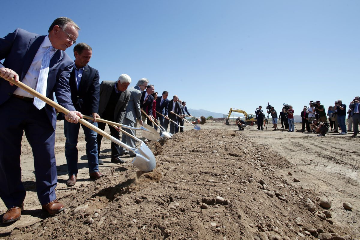Officials uses shovels to symbolically break ground as Northrop Grumman begins work on amissile defense development facility in Roy on Tuesday, Aug. 27, 2019.