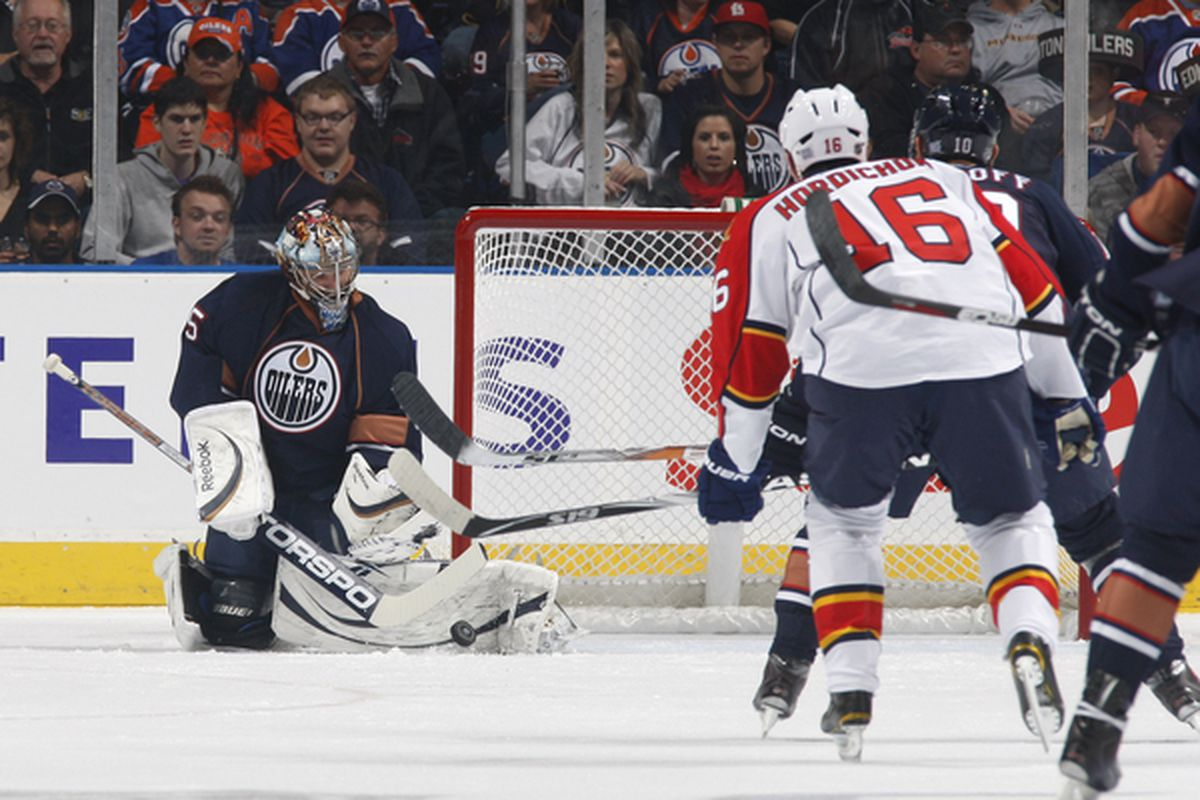 EDMONTON, CANADA - OCTOBER 10:  Nik Khabibulin #35 of the Edmonton Oilers makes a save off a shot by the Florida Panthers in first-period action at Rexall Place October 10, 2010 in Edmonton, Alberta, Canada. (Photo by Dale MacMillan/Getty Images)