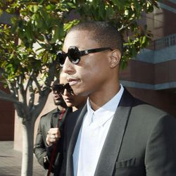 """Pharrell Williams leaves Los Angeles Federal Court after testifying at a trial in Los Angeles, Wednesday, March 4, 2015. The Grammy-winning singer says he wasn't trying to copy the late Marvin Gaye's music for the hit song """"Blurred Lines,"""" but he was trying to evoke the feeling of late 1970s tunes. Williams is being sued by Gaye's children, who claim """"Blurred Lines"""" improperly copies their father's hit """"Got to Give it Up."""" Singer Robin Thicke and rapper T.I. are also defendants in the case."""