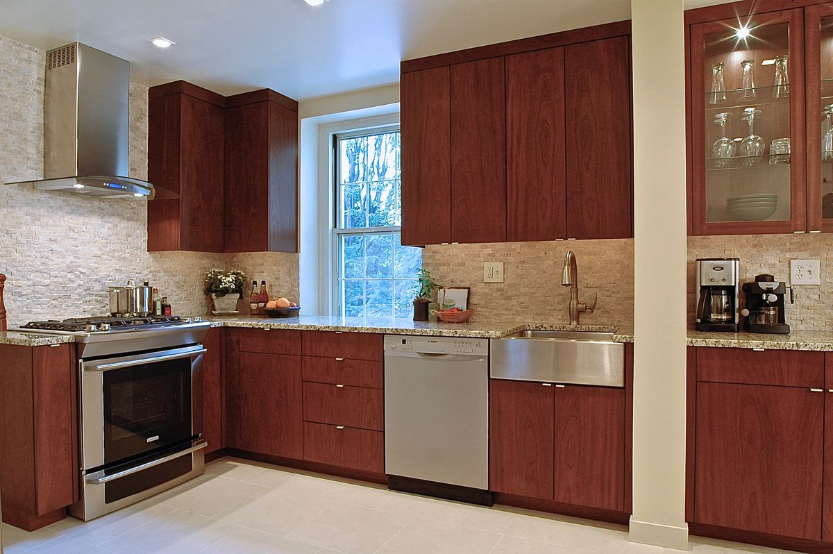 A contemporary kitchen with cherry wood cabinets