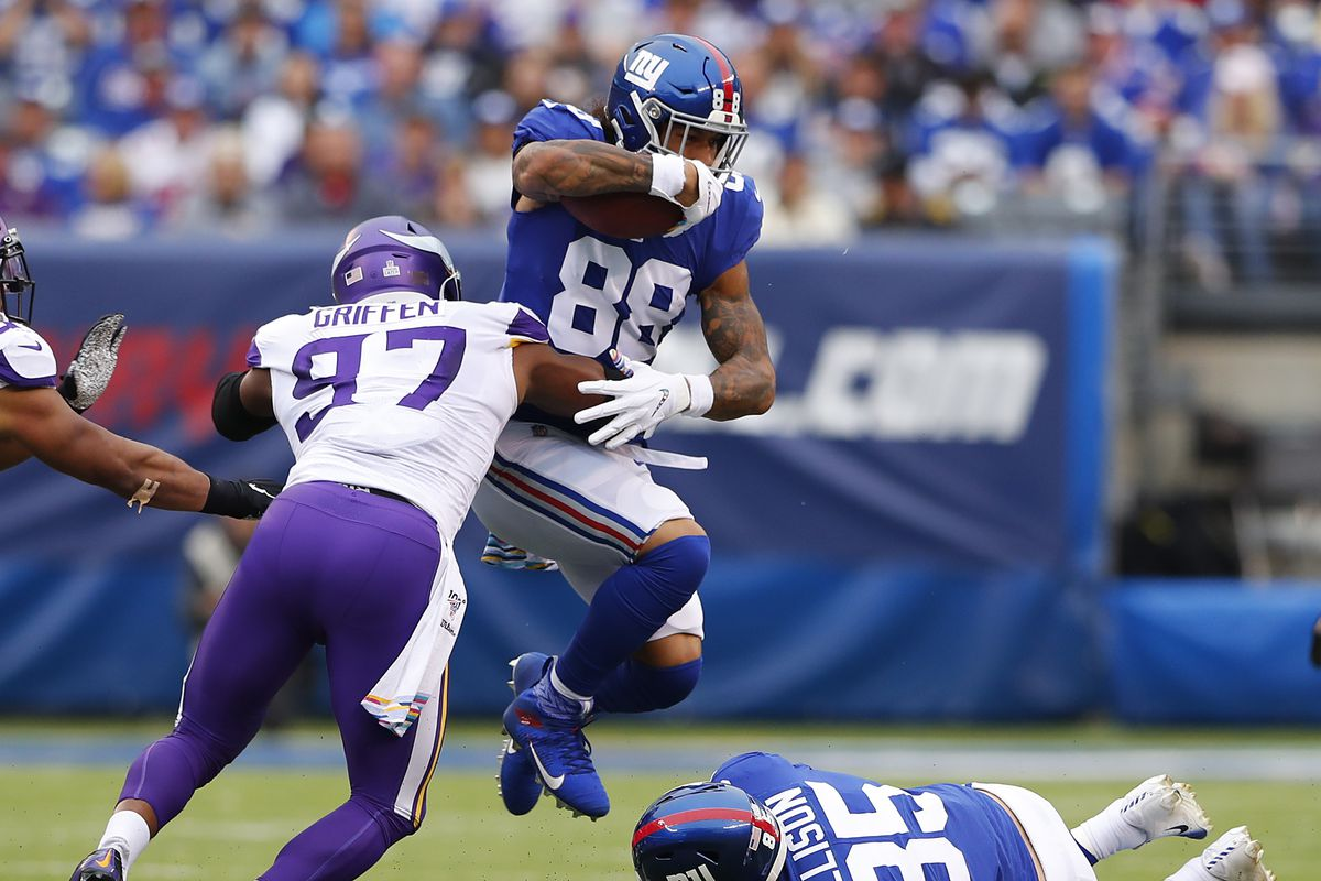 New York Giants tight end Evan Engram is tackled by Minnesota Vikings defensive end Everson Griffen during the first half at MetLife Stadium.