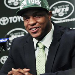 New York Jets first-round NFL football draft pick Quinton Coples smiles as he answers a question during a news conference, Friday, April 27, 2012, in Florham Park, N.J.