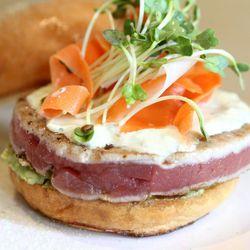 Ahi Tuna Burger, with seared ahi, crushed avocado, gingered carrots, wasabi tartar, sprouts