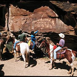 Riders travel through Nine Mile Canyon, the main feature of which is a collection of Indian rock art.