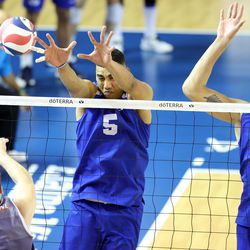 BYU's Gabi Garcia Fernandez and Felipe de Brito Ferreira work to block the shot of Pepperdine's Spencer Wickens as they play in the finals of the Mountain Pacific Sports Federation Championship, at the Smith Field House in Provo on Saturday, April 24, 2021. BYU won in straight sets.