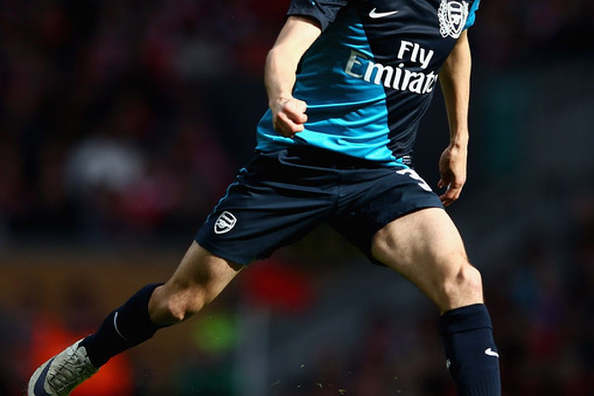 LIVERPOOL, ENGLAND - MARCH 03:  Yossi Benayoun of Arsenal with the ball during the Barclays Premier League match between Liverpool and Arsenal at Anfield on March 3, 2012 in Liverpool, England.  (Photo by Clive Mason/Getty Images)
